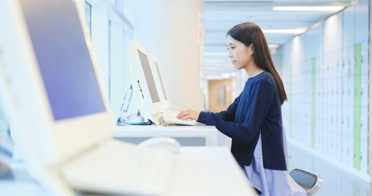 Medical student using computer at university